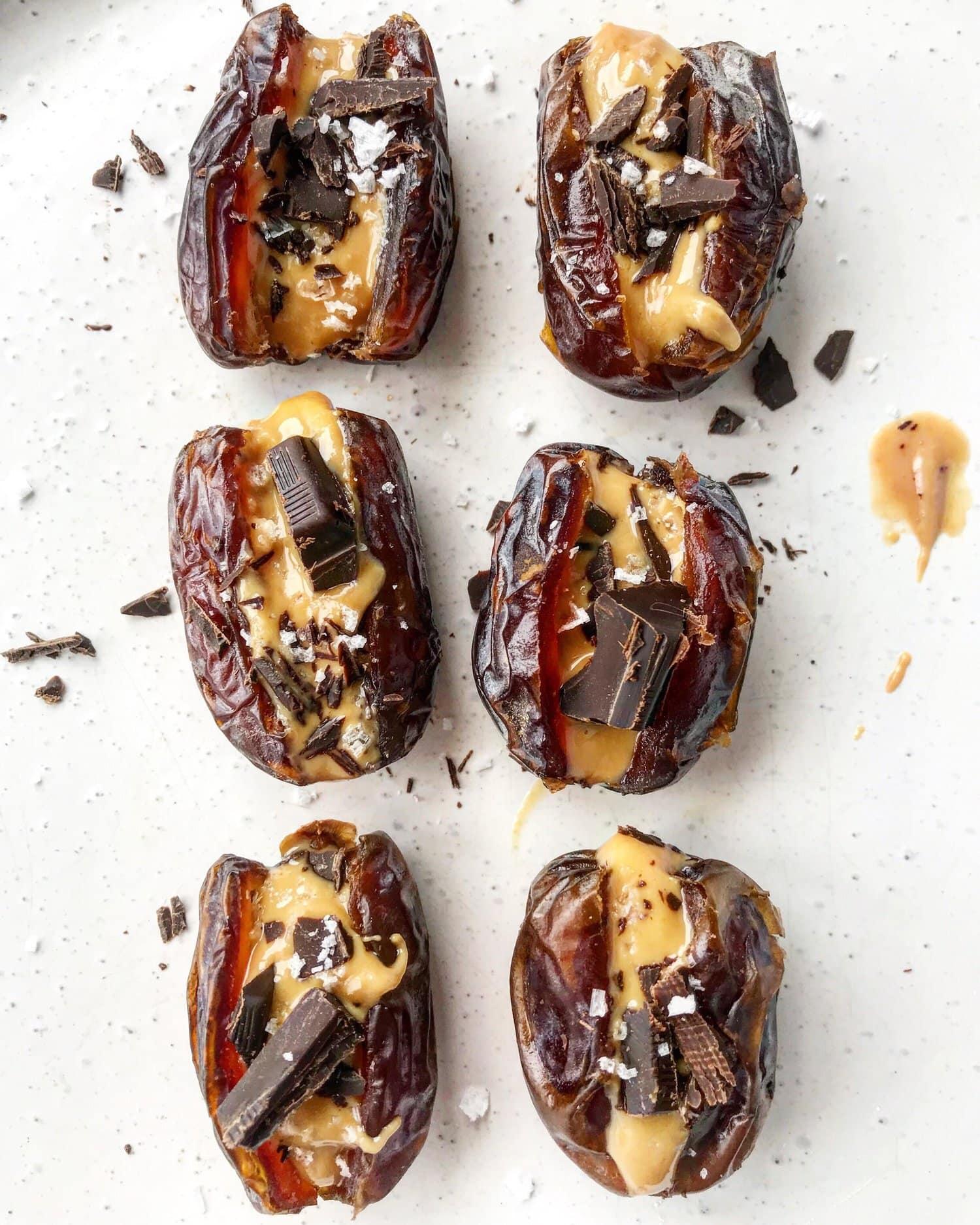 Stuffed medjool dates with peanut butter, dark chocolate and sea salt.