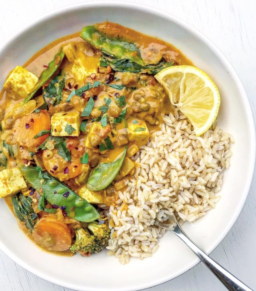 A bowl of lentil, vegetable and coconut curry.