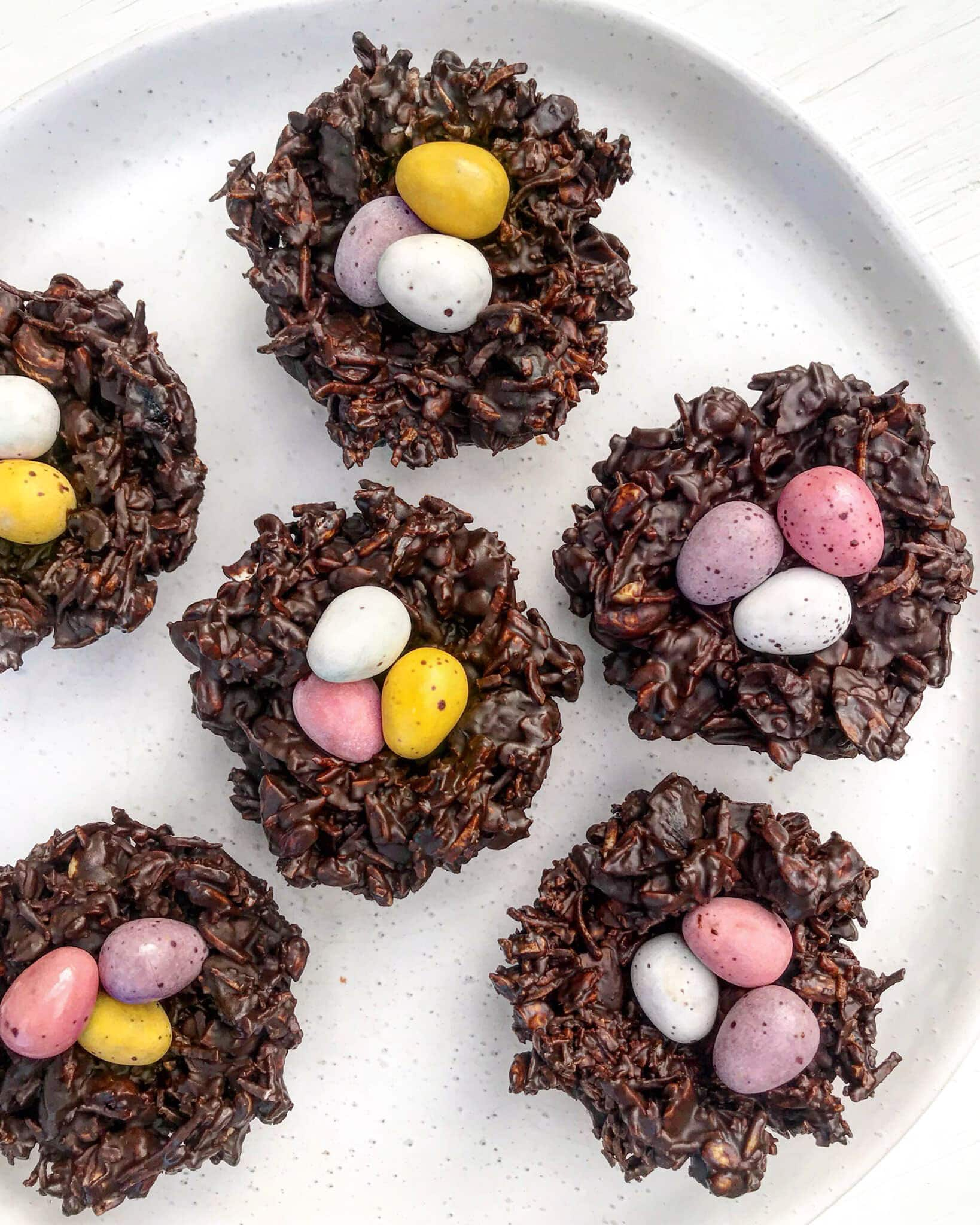 Chocolate easter nest topped with easter eggs.