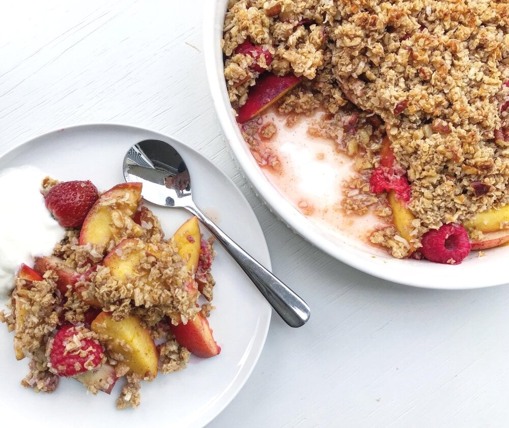 Close up of stone fruit and berry crumble.