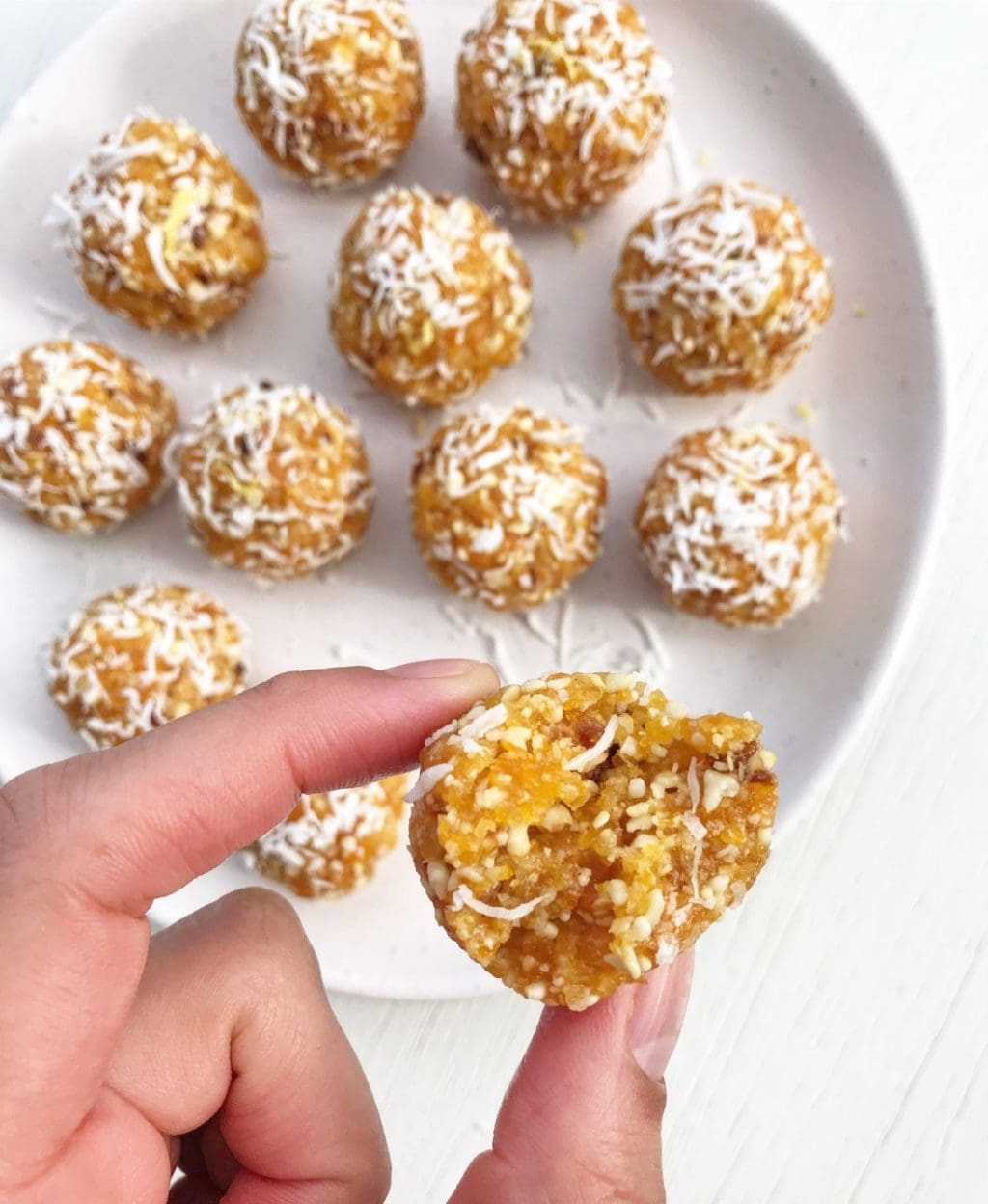 A plate of lemon, apricot and coconut bliss balls.