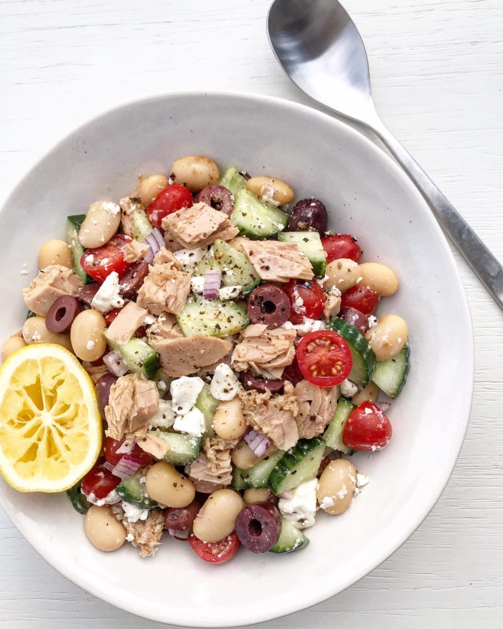 Tuna Greek-style salad with olives and feta in a bowl.