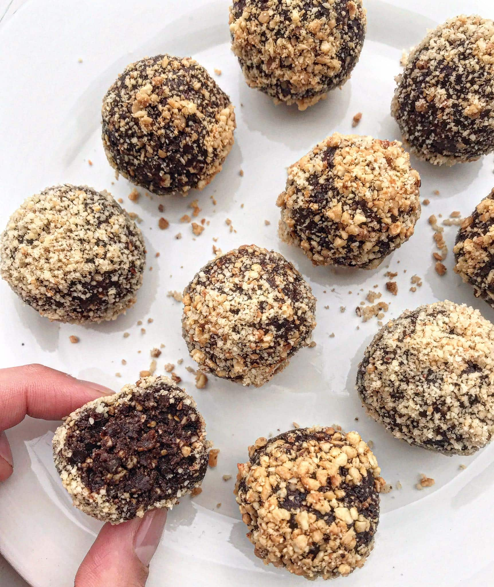A picture of chocolate hazelnut bliss balls on a white plate.